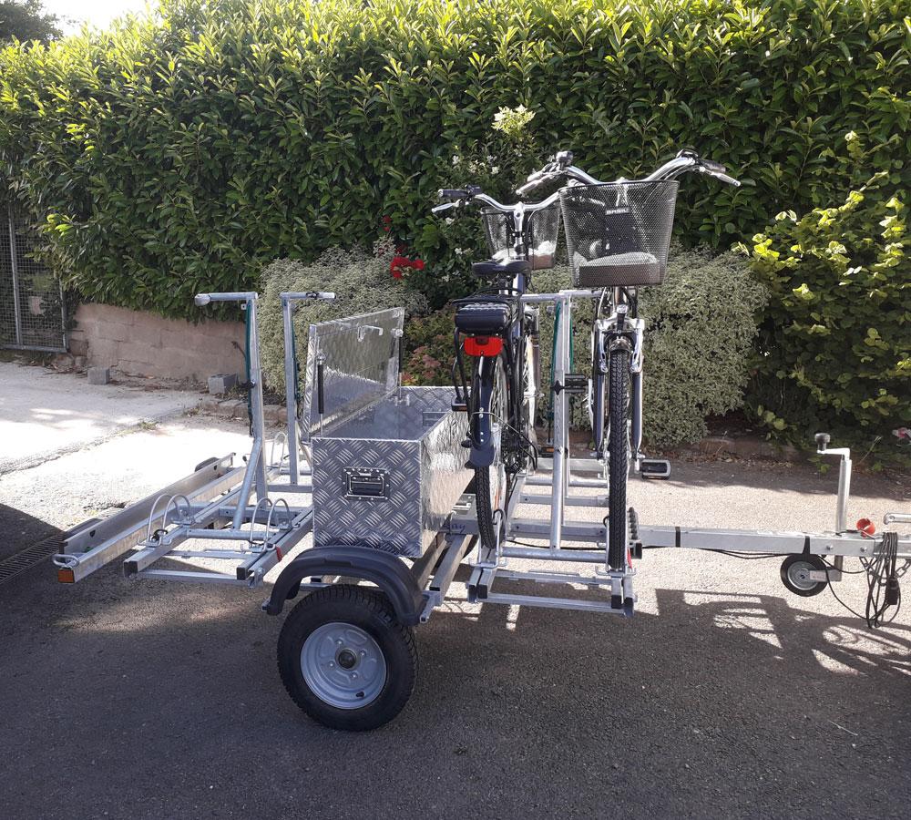 remorque adam - location remorque  pour le transport de 4 vélos électrique - avec coffre de rangement